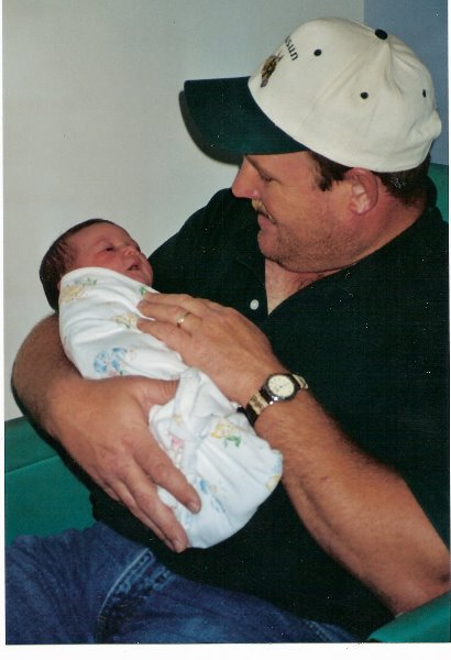 1999-10-28-pa-holding-savannah-in-the-hospital-when-she-was-born