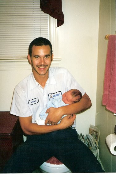 2001-7-20-brian-holding-his-new-brother-in-law-luke