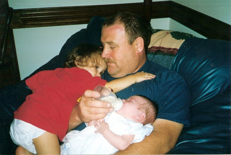 2001-7-savannah-is-making-sure-pa-still-has-room-for-her-in-his-lap-beside-of-luke