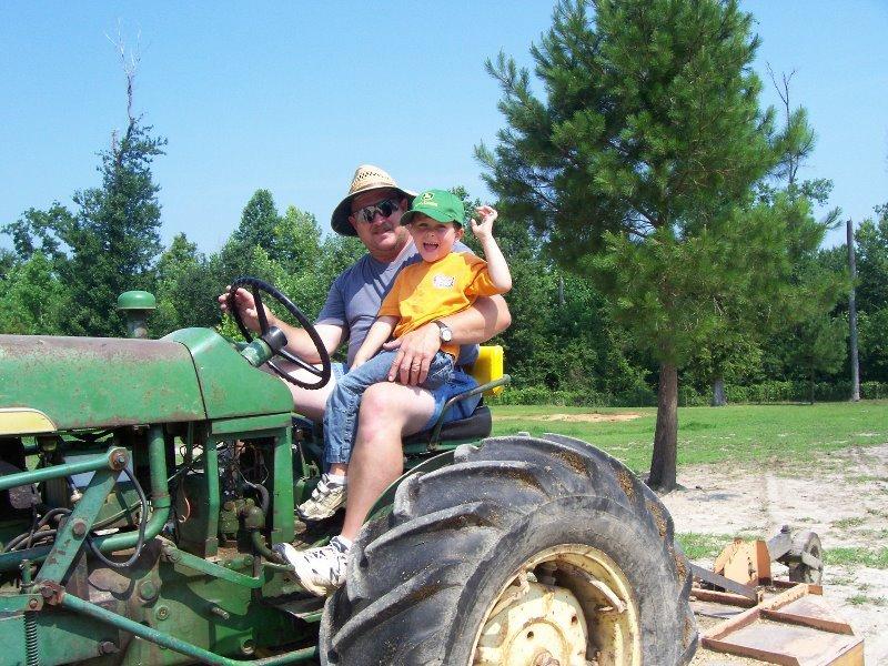 2006-7-david-luke-mowing-pastures-at-arrowhead-acres
