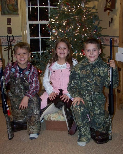 2009-12-25-luke-and-scott-decked-out-for-duck-hunting-and-savannah-ready-for-a-ride-in-the-cold-on-her-new-saddle