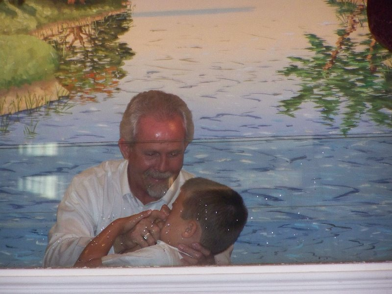 2009-7-19-savannahscott-luke-getting-baptized-after-they-all-three-accepted-christ-thru-the-year-in-2007-2008-2