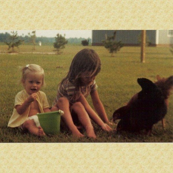 1984meholley-feedingchickens