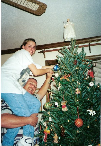 1997-novemb-er-our-1st-christmas-with-david-david-held-wendy-up-to-put-the-star-on-the-christmas-tree